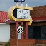 Across the street from the Drine-In Tattoo Shop.