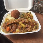 Curry goat, beef patty, and the menu
