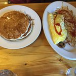 Omelette, hash browns, and huckleberry pancakes
