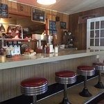 Front counter with vintage stools, and a view into the kitchen