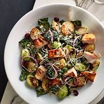 Warm kale salad with mini roast potatoes, brussels sprouts, and either chicken or prawns - VERY
