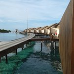 As we came out of our villa , a walk along the jetty to go for breakfast , please don't wear hea