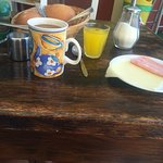 Bed and breakfast. Stakle bread cakes, dilute orange juice, coffee, one slice of ham & cheese