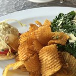 Chopped devilled egg on tomato with kale Caesar salad and chips