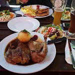 Roasted duck with potato and salad on the side
