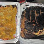 Curried goat on the left, jerk pork ribs on the right, delicious!