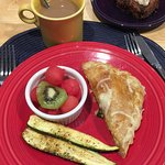 Garden scrambled eggs in puff pastry, fresh fruit and banana bread! Best breakfast!