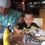 Husband and son after dinner at River Grille On the Tomoka