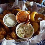 Shrimp Basket, slaw with shrimp, onion rings and hush puppies