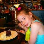 enjoying her free birthday muffin.