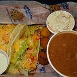 My tacos w cole slaw and beans/rice side (rice is under beans). Delicious!