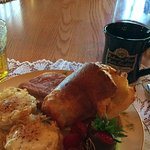 Fresh popovers, eggs in a hash brown nest, fresh fruit, juice and choc-covered strawberries!