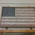 This is the American Flag made out of rocks. It is tremendously heavy and is hung at the door
