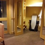 Walk - in wardrobe with dressing table/mirror and ironing facilities