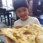 BAby Picking up a Naan