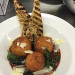 Monday blue plate special Italian sausage stuffed risotto balls marina parmigiana and grilled ci