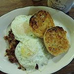 Pastrami hash with eggs and English muffins.