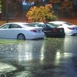 Flooded vehicles due to poor drainage and slope of parking lot. Mgmt aware. Do nothing to avert!