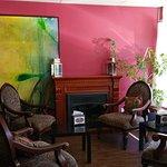 Comfy, sunny seating area with original art