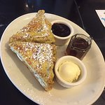 Fabulous French toast infused with orange, plus blue and black berry compote.