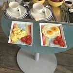 The full breakfast! White and brown toast, fruit bowls, tea, eggs and tomatoes!