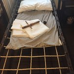 Soldier's cot. Wooden tool (on sheet)to tighten the ropes- thus the phrase- sleep tight!!!