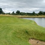 5th hole , elavated tee to green with water right , Pin cut in the lake on this photo lol