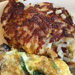 Close-up of hash browns and spinach mushroom cheese omelette