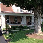The front porch with lounging chairs await you!