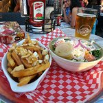 Poutine and salad combo, and a pint of blonde beer