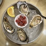 Oysters, with a rather chunky, peppery and sweet mignonette