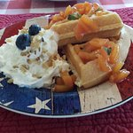 Waffle with peach compote and fresh whipped cream