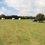 Caravan pitches set back from the tents!