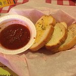 Complimentary bread and marinara dipping sauce.