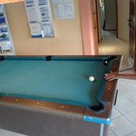 Pool table next to the bar - always handy!