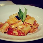 Delicious Paccheri rigatoni with white fish, aubergines Caviar and light basil dressing.