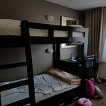 kids bunk beds in a spacious room - with strange mini pillows