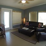 Wide angle shot of living room in unit 6