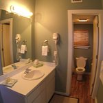 Same bathroom in all five units. Shower/tub adjacent to toilet