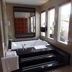 Sunken bath and jacuzzi with lighting.
