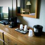 Tv, coffee pot, microwave, refrigerator.