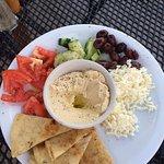 Hummus, tomatoes, cucumbers, Greek olives, feta and pita