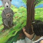 Artist of all our murals, Ellie Vega