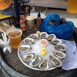 Oysters and beer on a barrel...PERFECT!