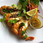 Grilled prawns with spicy lemon dipping sauce.