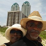 Wife & i at the beach with hotel in back ground Pearl South.