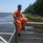 Son on dock adjacent to boat ramp