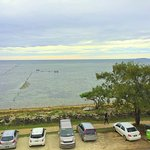 From our balcony - our rental car parked across the road, and the sea beyond (not a swimming bea