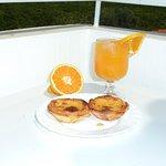 fresh orange juice and pastel de nata