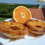 Fresh orange and pastel de nata